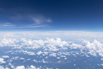 Blue sky background and white clouds soft focus.Aerial veiw landscape from airplane window.