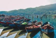 Wooden Boats Lined Up At Fishing Village Lang Co, Hue, Vietnam.