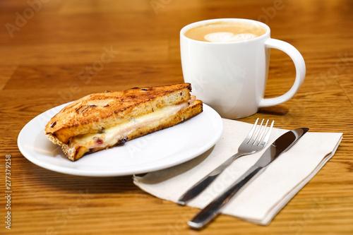 Fototapeta Sandwish and coffee on the wood table in the morning. obraz