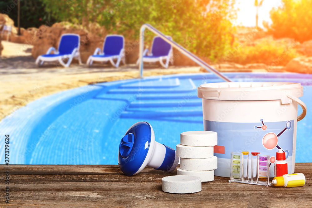 Fototapety, obrazy: Equipment with chemical cleaning products and tools for the maintenance of the swimming pool.