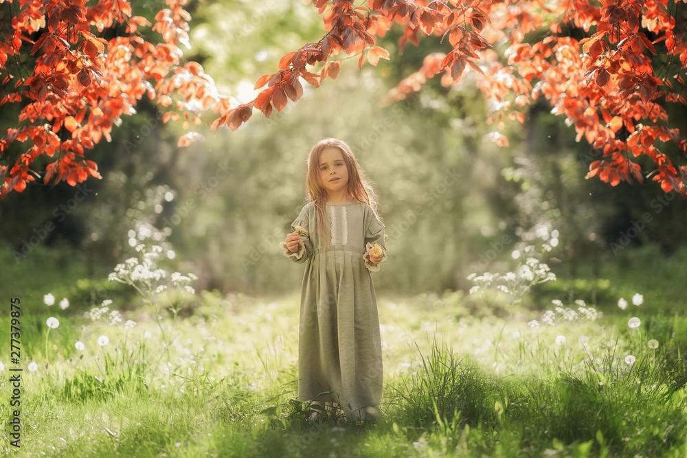Fototapety, obrazy: Full Length shot of cute girl holding flower in the hand in the green park