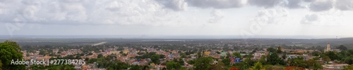 Photo  Aerial panoramic view of a small touristic Cuban Town during a colorful and cloudy sunset