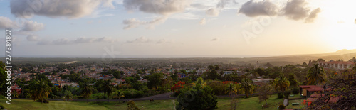 Aerial panoramic view of a small touristic Cuban Town during a colorful and cloudy sunset Wallpaper Mural
