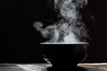 Bowl Of Hot Soup. Steam Of Hot Soup With Smoke Wood Bowl On Dark Background.selective Focus,hot Food Concept