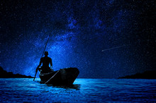 African Boatman With His Canoe...