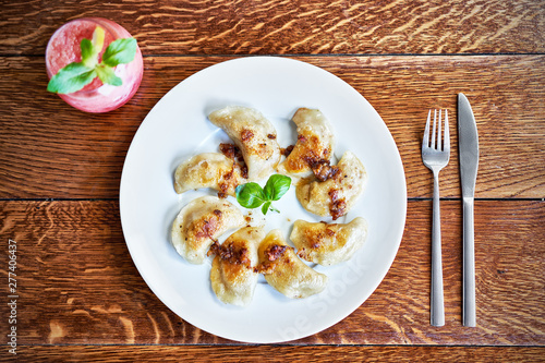 Fresh dumplings served on white plate