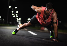 Fitness Men Doing Push Ups On The Road At Night.