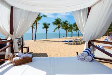 Fototapeta na wymiar Luxury bed on a beach