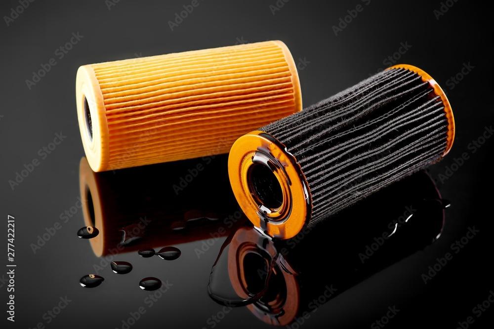 Fototapeta car engine oil filter on dark background