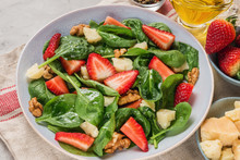 Summer Strawberry Salad With Spinach Leaves, Parmesan Cheese, Olive Oil And Walnuts. Healthy Keto Diet Food