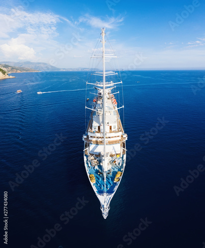 Yacht on the water surface from top view. Blue sea water background from top view. Summer seascape from air. Croatia. Travel - image