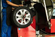 Man Worker With Wheel Balancin...