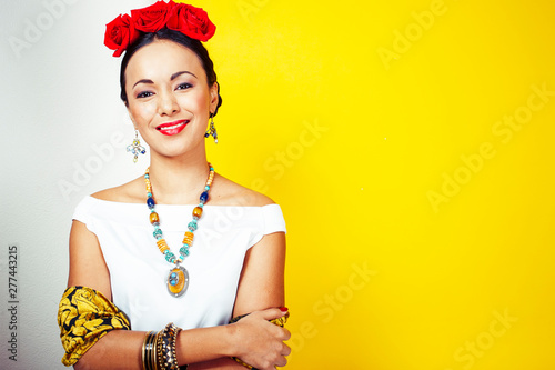 Pinturas sobre lienzo  young pretty mexican woman smiling happy on yellow background, lifestyle people