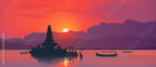 Red sunset with silhouette of famous balinese Ulun Danu water temple and fisherman boats on lake Bratan, Bali, Indonesia Canvas Print