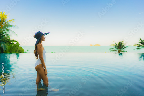 Fotografie, Obraz  Portrait beautiful young asian woman relax in luxury outdoor swimming pool in ho