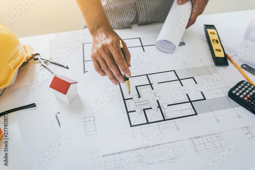 Photo Blueprints of designer and engineers working at architects office