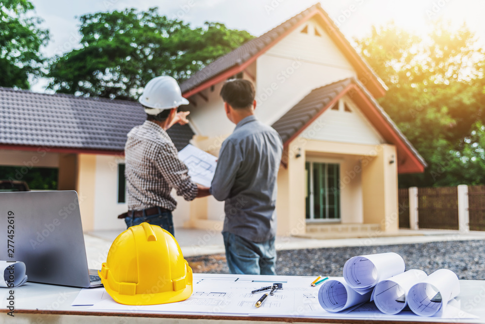 Fototapeta Two business man professional engineer worker at the house building.