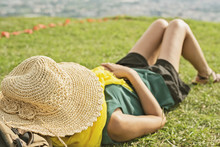 Woman Lie On Grassland And Feel Relax