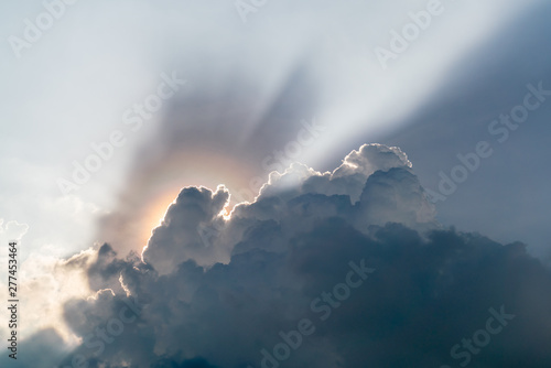 Fotografie, Tablou  Sun rays are striking through the clouds like an explosion