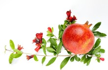 Ripe Pomegranate With Pomegranate Flowers And Leaves On A Light Background