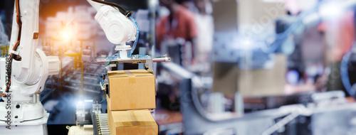 Obraz na płótnie Industrial Robot arm control holding package box