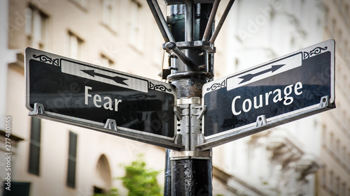 Street Sign to Courage versus Fear Fototapet
