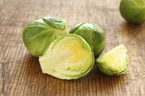 Poster Brussels fresh brussels sprouts on a wooden board