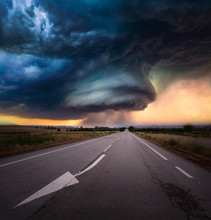 Super Cell Storm In Kansas Eeuu With A Road And Sunset Light