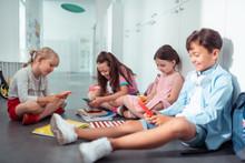 Children Addicted To Smartphones Using Them During Break At School