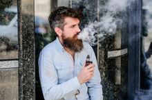 Habits Concept. Man Smoking E-...