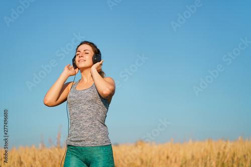 Enjoy music, clear sound, freedom, technology  Sporty woman