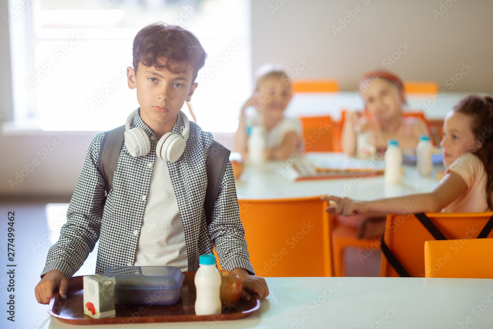 Fototapety, obrazy: Dark-haired boy feeling like outcast while eating alone in canteen
