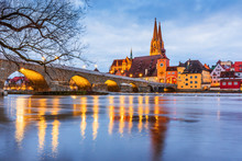 Regensburg, Germany. View From Danube Of Regensburg Cathedral And Stone Bridge.