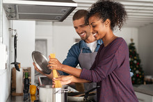 Young Couple Cooking Italian Pasta