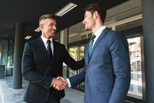 Portrait Closeup Of Two Successful Businessmen Partners Shaking Hands Outside Job Center During Working Meeting