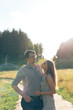 young couple in love on nature at sunset