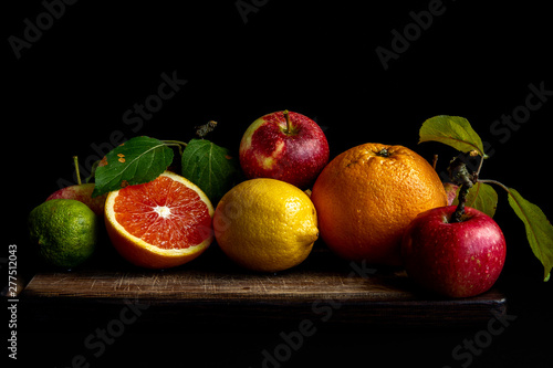 Fresh fruits on wooden plank