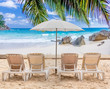 chairs and umbrella on tropical beach, Seychelles Islands