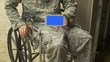army man holding ipad with screen