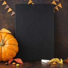Fall Chalkboard Background With Pumpkin, Leaves And Candies.