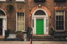 Old House With Green Front Door And Red Brick Wall In Dublin, Ireland