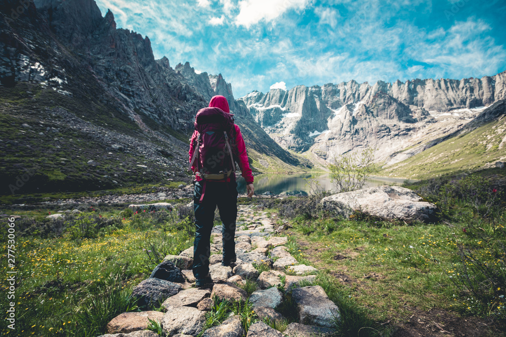 Fototapety, obrazy: Woman hiker hiking on high altitude mountains