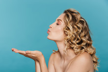 Image In Profile Of Young Shirtless Woman 20s With Curly Blond Hair Blowing Air Kiss At Copyspace