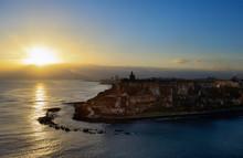 Coastline Of San Juan, Puerto Rico And Fortress The Castillo San Felipe Del Morro On Sunrise