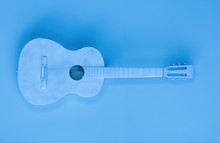 Blue Guitar Isolated On Blue Background