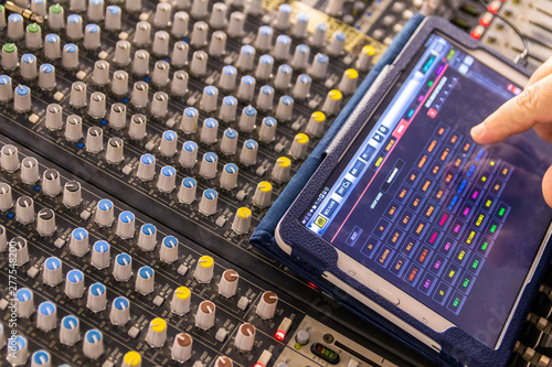 Sound engineer behind the sound mixing console controls the sound - 277548200
