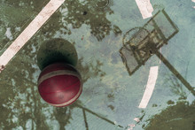 Basketball Hoop With Reflective Water After Rain At Outdoor Basketball Court.