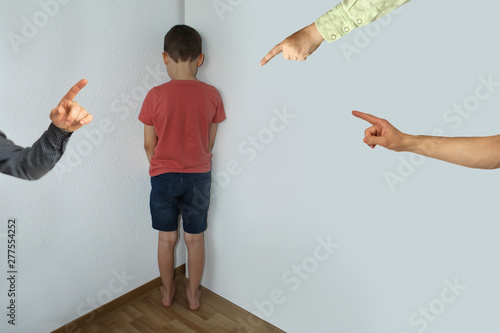 Cuadros en Lienzo a punished boy, a junior schoolboy, is standing in the corner, facing the wall,