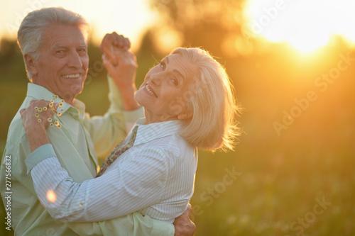 Fotografie, Obraz  Portrait of beautiful senior couple dancing in the summer park