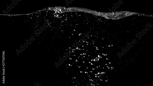 Blurry images of drinking water liquid bubbles or carbonate drink or oil shape or soda splashing and floating drop in black background for represent sparkling refreshment and refreshing - 277567046